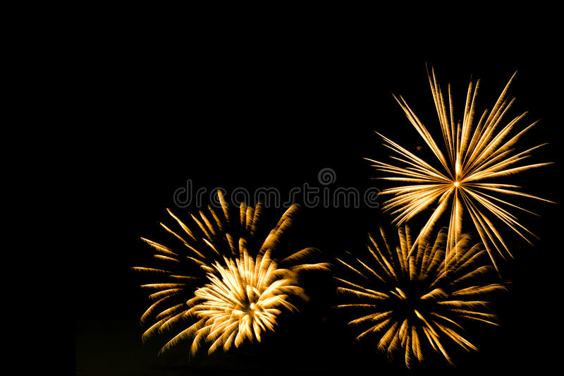Golden fireworks border on the black sky background stock image