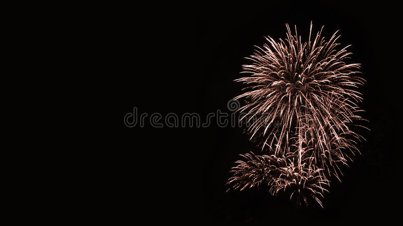 Golden fireworks in the night sky. stock photos