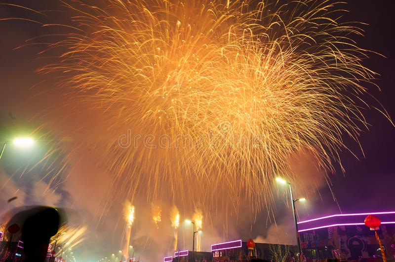 The golden fireworks reach on the Motor city. The photo was taken in Motor City of Daqing city,Heilongjiang province, China.It was setting off fireworks to stock photos