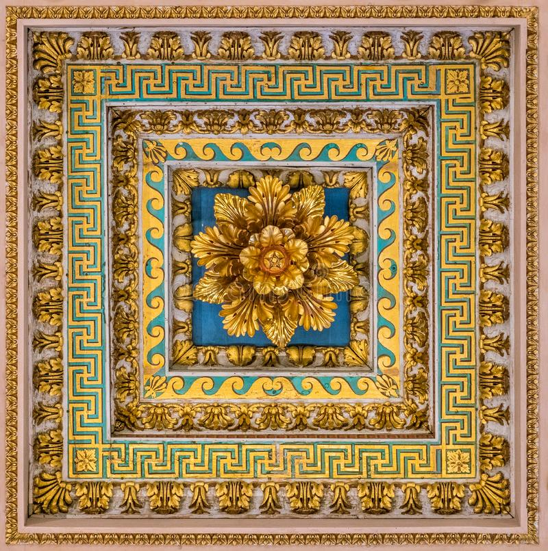 Golden floral decoration from the ceiling of the Basilica of Saint Paul Outside the Walls, in Rome. The Papal Basilica of St. Paul Outside the Walls, commonly stock image