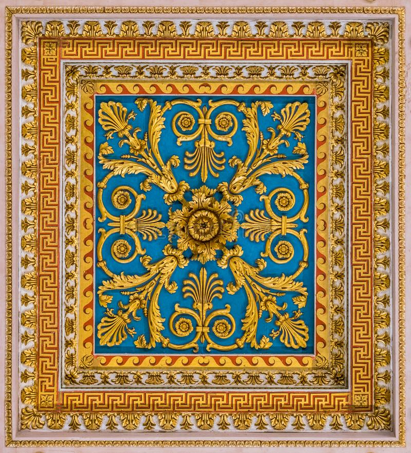 Golden floral decoration from the ceiling of the Basilica of Saint Paul Outside the Walls, in Rome. The Papal Basilica of St. Paul Outside the Walls, commonly stock photo