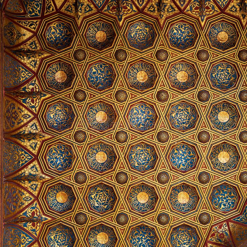 Golden floral pattern decorations of ceiling of Mausoleum of Sultan Qalawun, Medieval Cairo, Egypt royalty free stock images