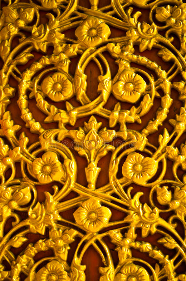 Golden flower pattern on the door. Golden flower pattern on the temple's door stock images