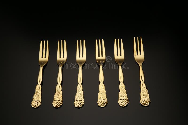 Golden fork stock image