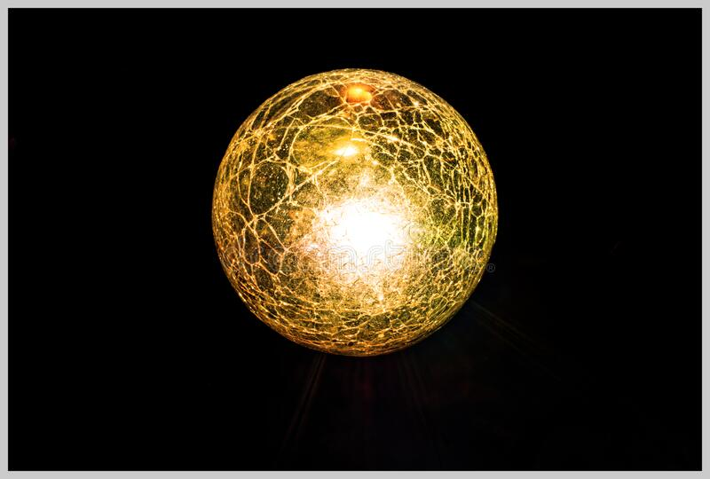 Golden Globe in Black Background stock images