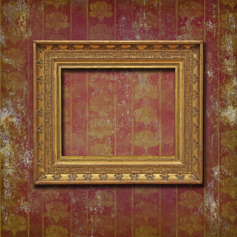 Golden frame on burgundy grunge wallpaper royalty free stock photography