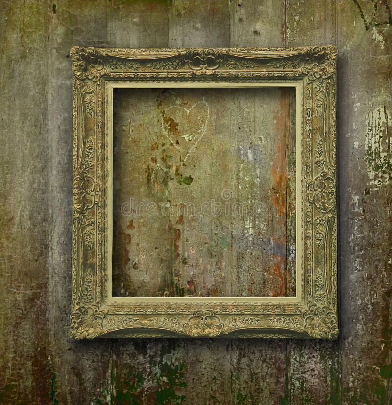 Golden frame on grunge wood wall stock photography