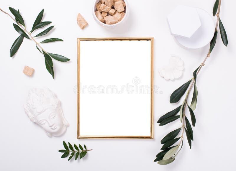 Golden frame mock-up on white tabletop stock photo