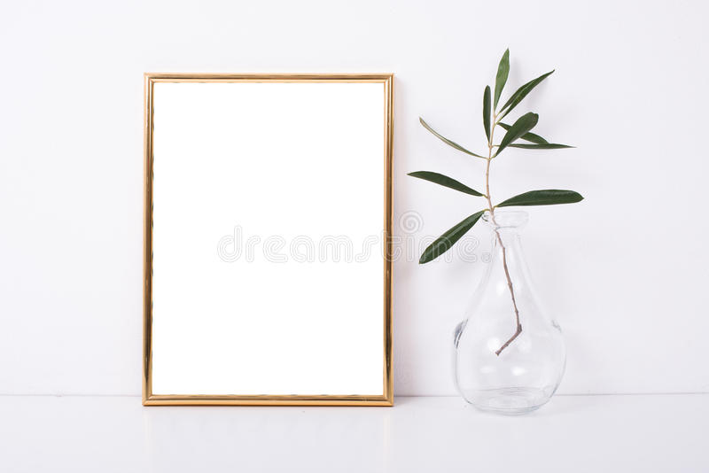 Golden frame mock-up on white wall stock images