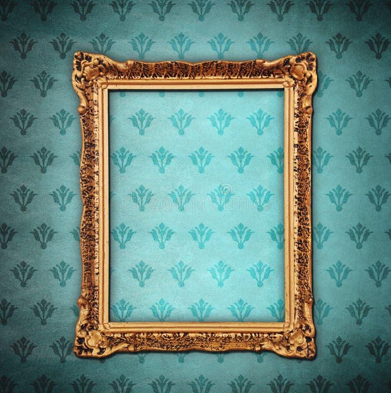 Golden frame over grunge wallpaper. Golden frame over grunge blue wallpaper royalty free stock photo
