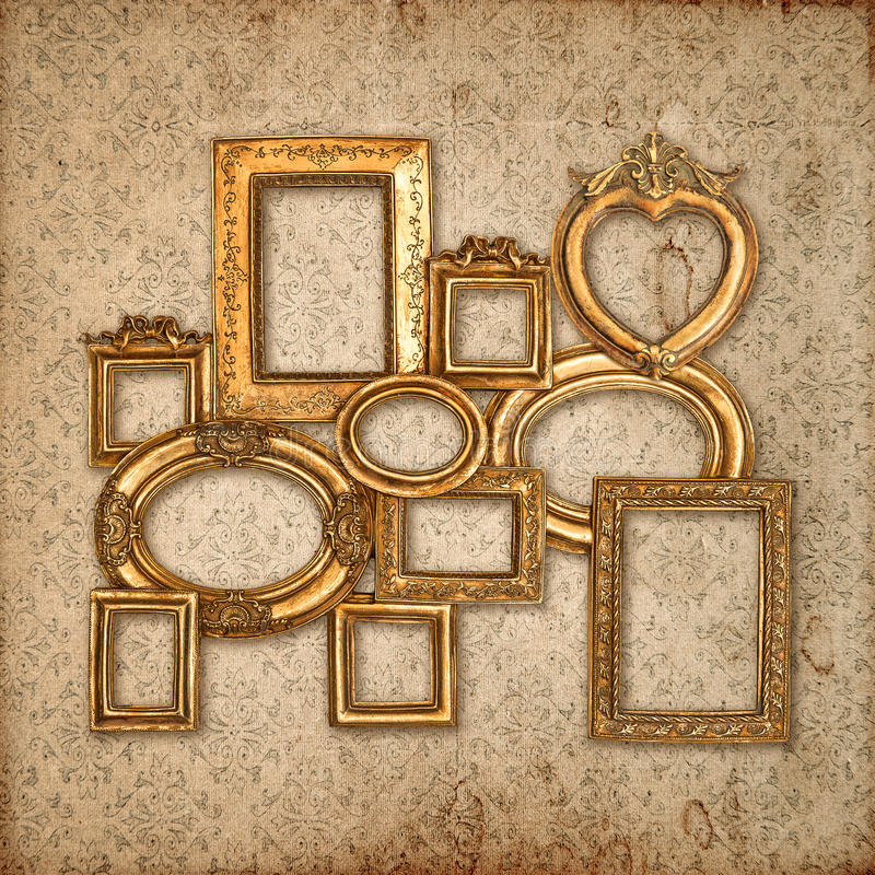 Golden framework over vintage pattern wallpaper stock image