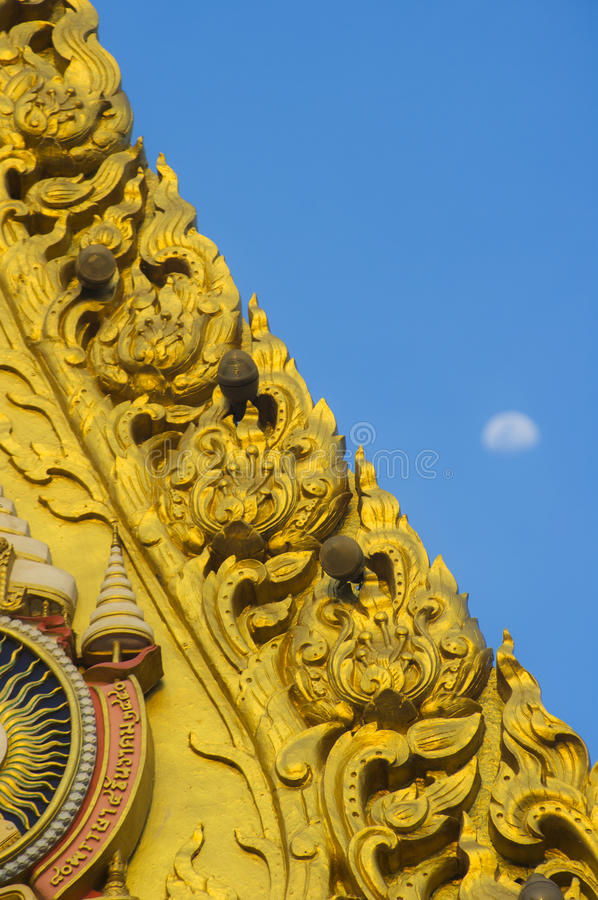 Golden gable. Detail of the ornate gilded woodcarving and roof tiling on the Grand Palace in Bangkok, Thailand royalty free stock photography