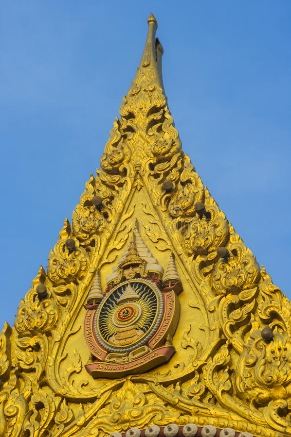 Golden gable. Detail of the ornate gilded woodcarving and roof tiling on the Grand Palace in Bangkok, Thailand royalty free stock images