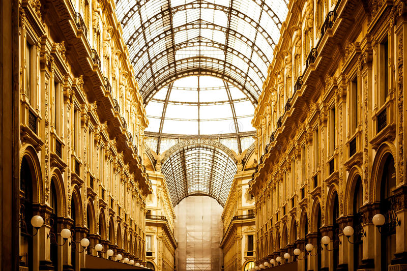 Golden light in Vittorio Emanuele's  gallery in Milan. Vittorio Emanuele's gallery from Milan Italy illuminated by suggestive golden light royalty free stock photo