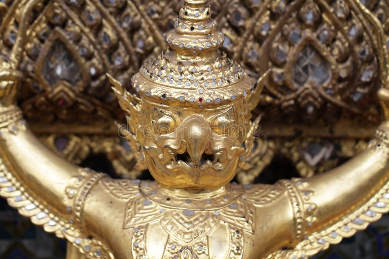 Golden Garuda statue stand around , the bronze symbol of Thai government, giant ancient gold eagle with crown sculpture. Group of golden Garuda statue stand stock photo