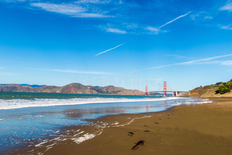 Golden Gate Bridge and Beach Footprints. San Francisco stock images