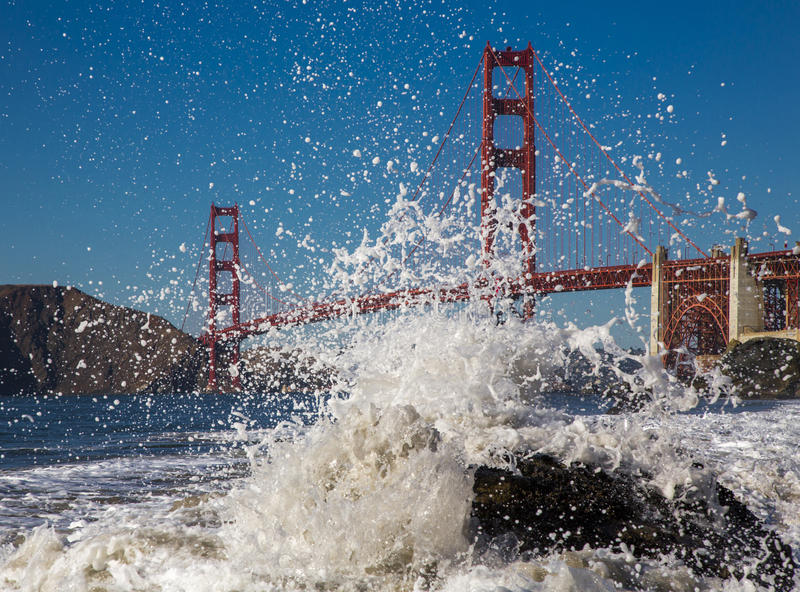 Golden Gate Bridge in California USA. Golden Gate Bridge in California and spray of the sea on the shore stock photo