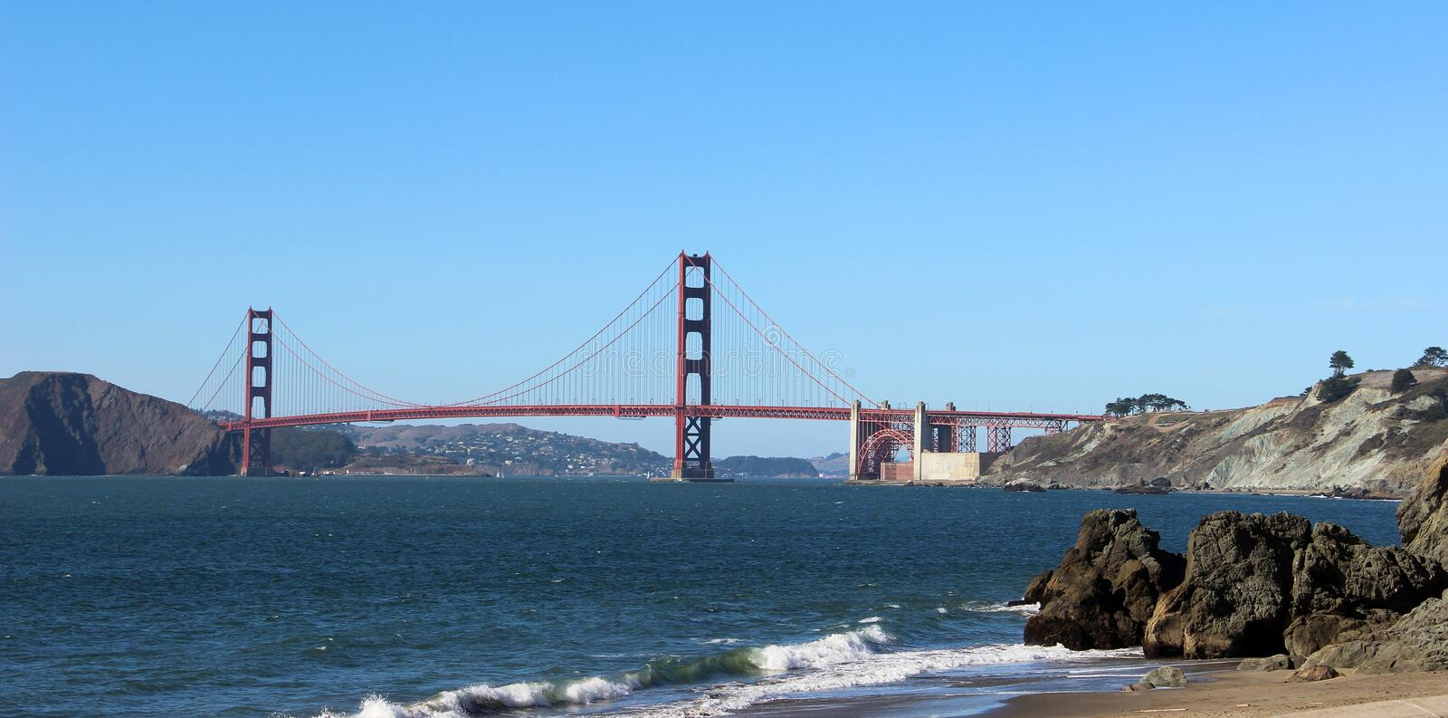 The Golden Gate Bridge, California,  United States of America. View of the bridge from the Baker beach. On a sunny summer day royalty free stock photos