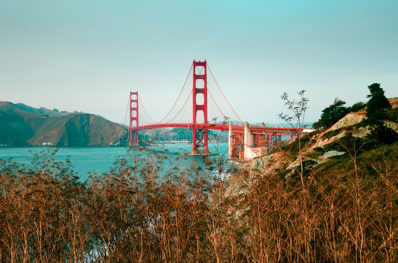 Golden Gate bridge daylight photo with the beach and the ocean royalty free stock image