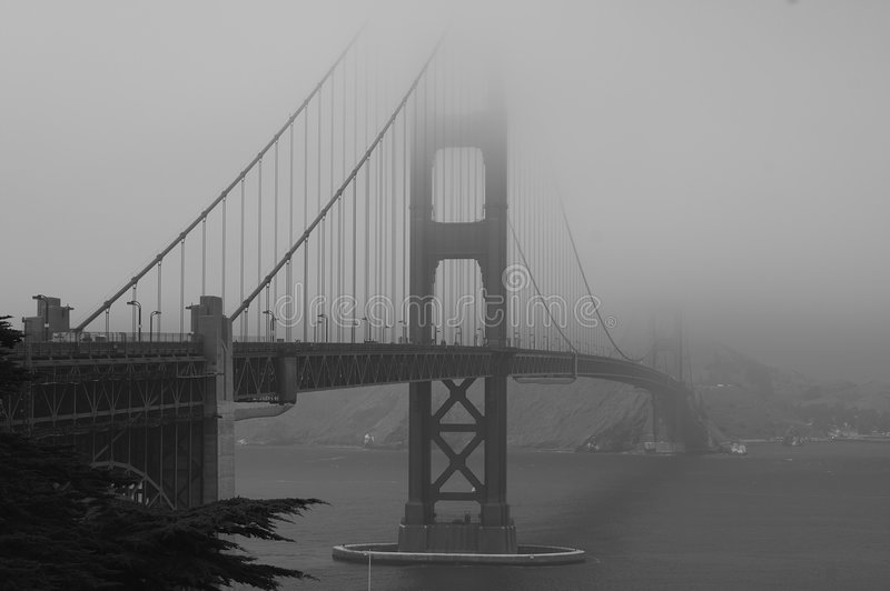 Golden Gate Bridge in fog b/w stock photo