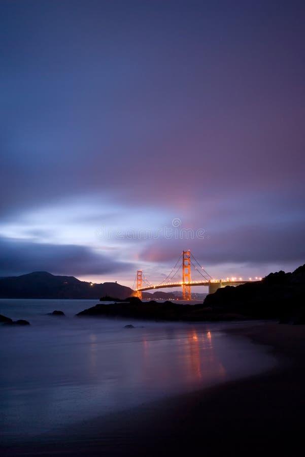Golden Gate Bridge at night. The famous San Francisco landmark Golden Gate Bridge, shot from the Baker Beach at night stock photography