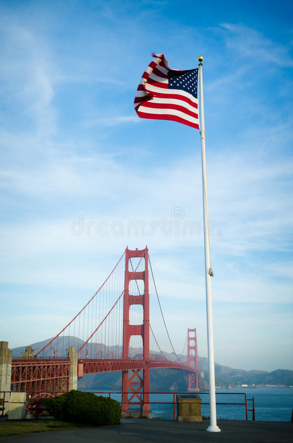 Golden Gate Bridge in San Francisco California and US flag stock images