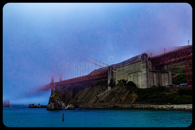Golden gate bridge San Francisco almost completely covered by fog royalty free stock photo