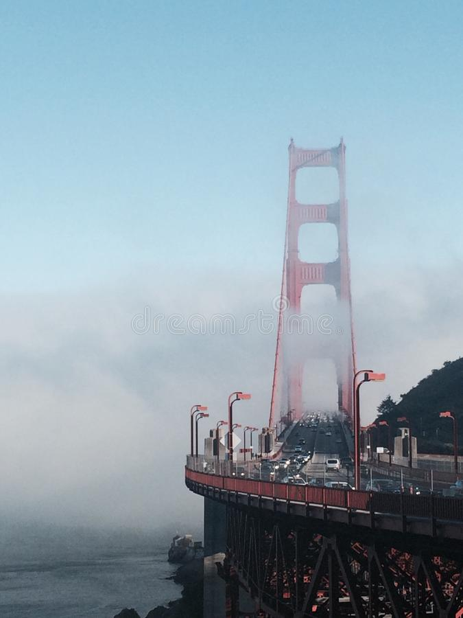 Golden gate in the fog. stock image