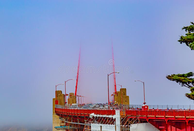 Golden gate bridge San Francisco on a foggy day with traffic on the bridge royalty free stock photo