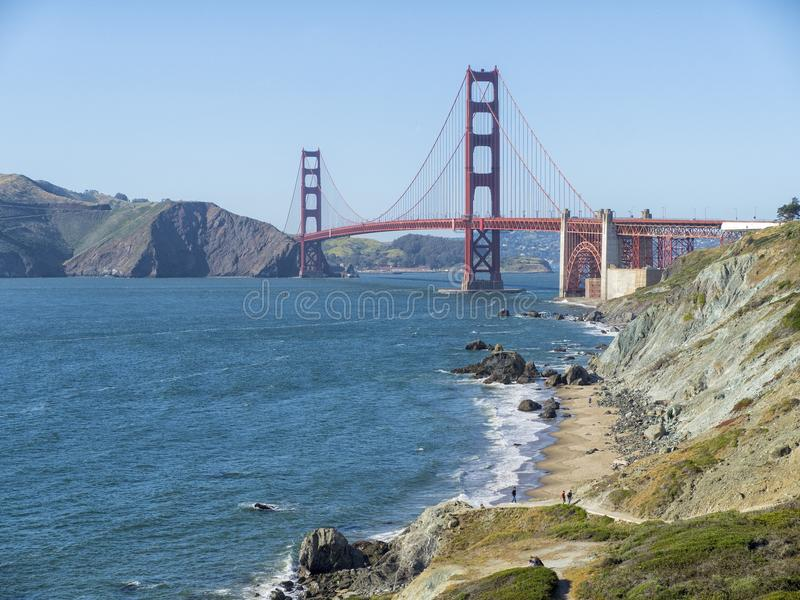 Golden Gate Bridge in San Francisco and Marshall`s beach on a summer day stock image