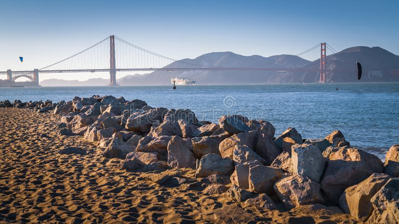 Big Cargo Vessel Under Golden Gate Bridge. Golden Gate Bridge, an awesome cargo boat arriving from an exotic and faraway place. I bet those kiteboarding fitness stock photos