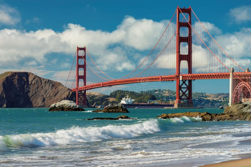 Golden Gate Bridge at sunny day from Baker Beach royalty free stock images