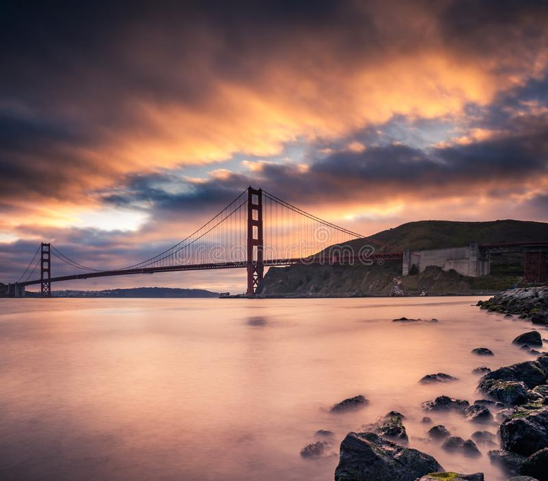Golden Gate Bridge with sunset clouds. This is a photograph of the Golden Gate Bridge San Francisco with sunset clouds stock photography
