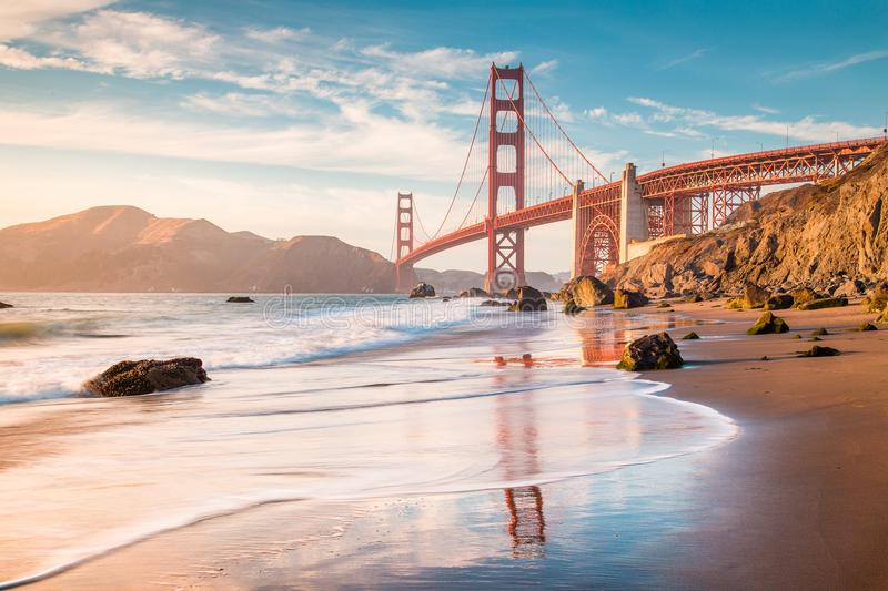 Golden Gate Bridge at sunset, San Francisco, California, USA. Classic panoramic view of famous Golden Gate Bridge seen from scenic Baker Beach in beautiful royalty free stock images