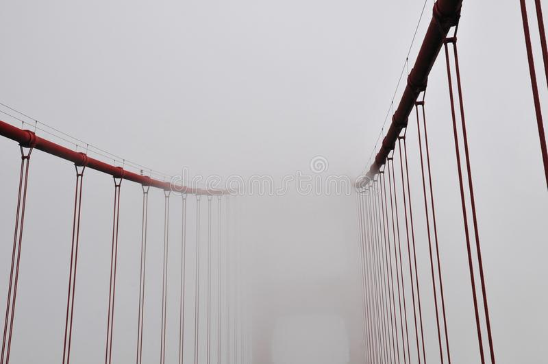 Creative, uncommon and unusual point of view and abstract of Golden Gate Bridge on a very foggy day San Francisco, California, USA royalty free stock image
