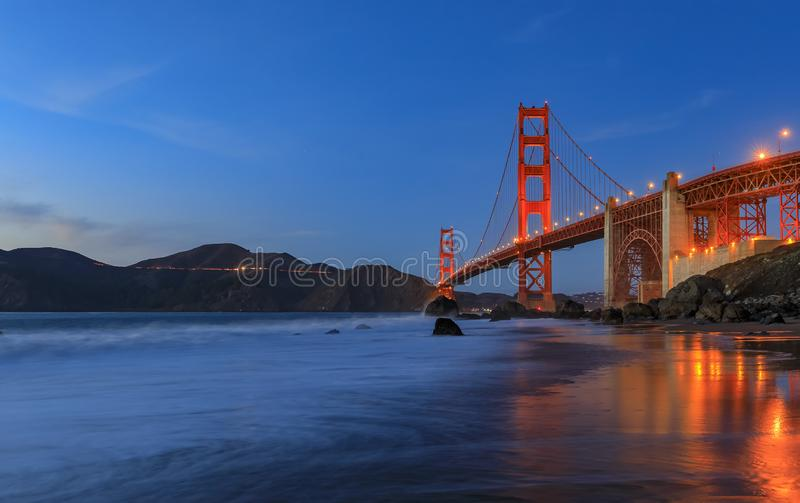 Golden Gate Bridge view from the hidden and secluded rocky Marshall& x27;s Beach at sunset in San Francisco, California royalty free stock photo