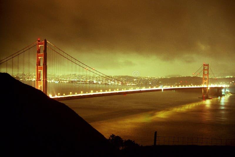 Golden Gate Glow. The nighttime glow of the Golden Gate Bridge stock image