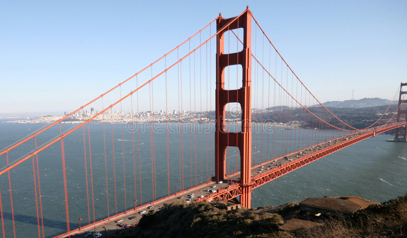Golden Gate landscape. Photo of Golden Gate bridge taken with the San Francisco in the background and calm weekend traffic on the bridge stock photos