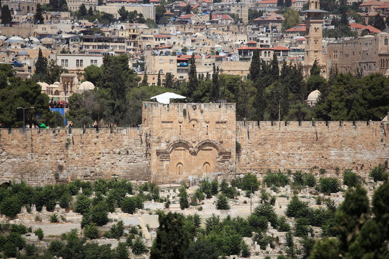 The Golden Gate from Mount of Olives, Israel. View of the Golden Gate of the walls of the old city of Jerusalem, Israel, from the Mount of Olives. The closed stock image