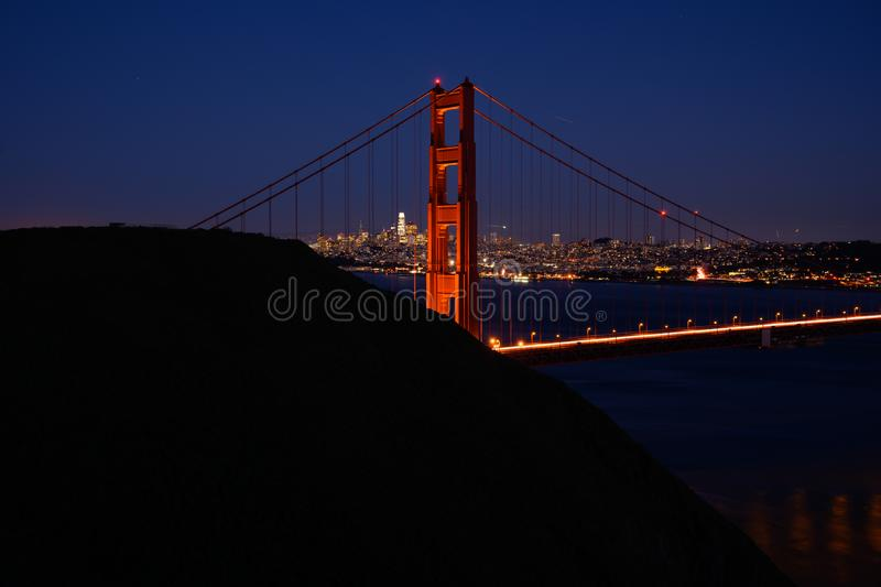 Golden Gate North Tower and Marin Headlands. Just after sunset stock image