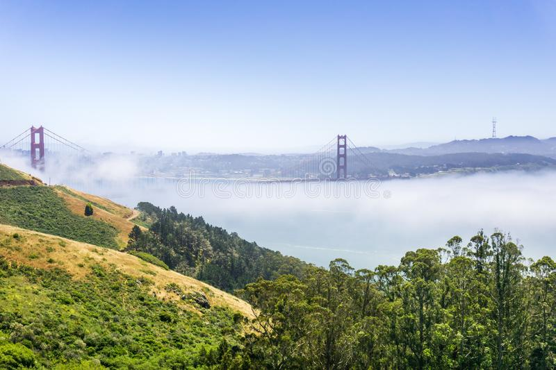 Golden Gate and the San Francisco bay covered by fog, as seen from the Marin Headlands State Park, California stock photos