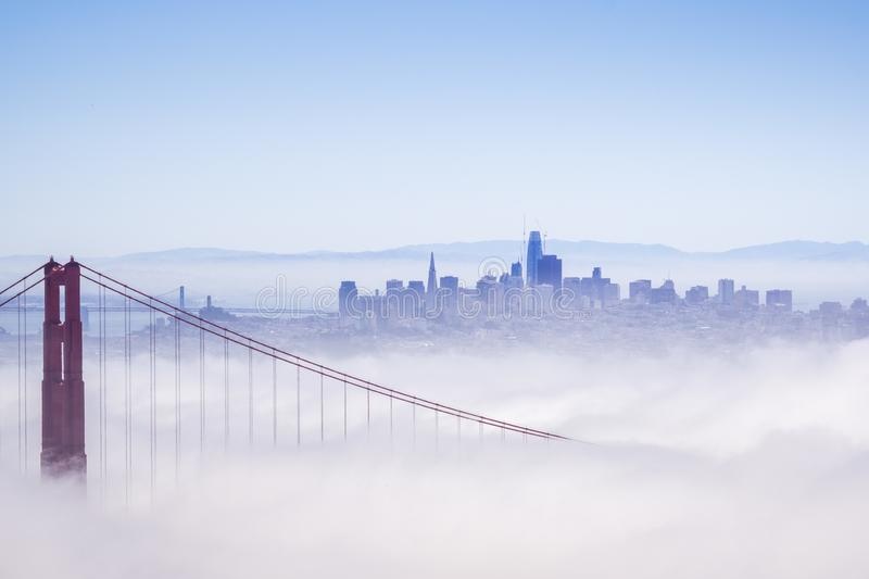 Golden Gate and the San Francisco bay covered by fog, the financial district skyline in the background, as seen from the Marin. Headlands State Park, California stock photos
