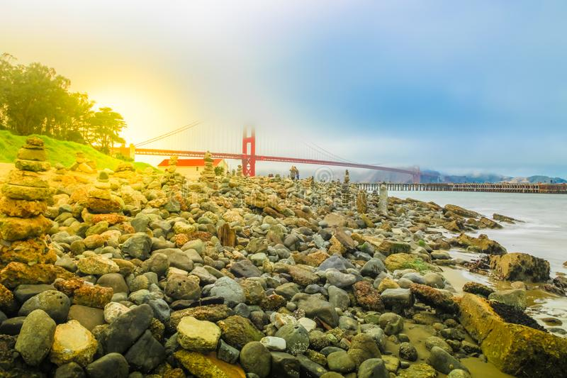 Golden Gate stone sculptures. Stone sculptures on the Crissy Field beach park with Golden Gate Bridge. People in leisure and recreational activities. San stock photography