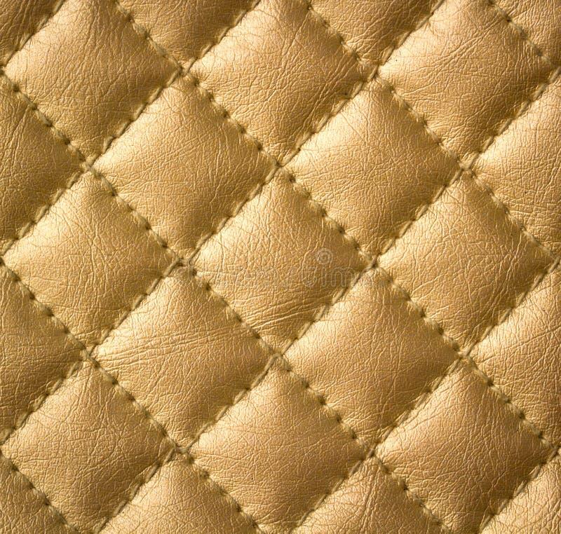 Golden Genuine Leather Texture. Beautiful Golden Genuine Leather Upholstery Texture royalty free stock image
