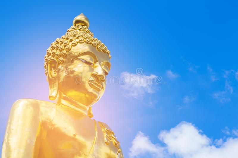 Golden giant buddha with blue sky royalty free stock images