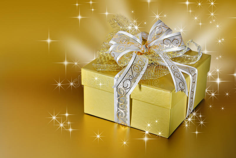 Golden gift box or present stock photos