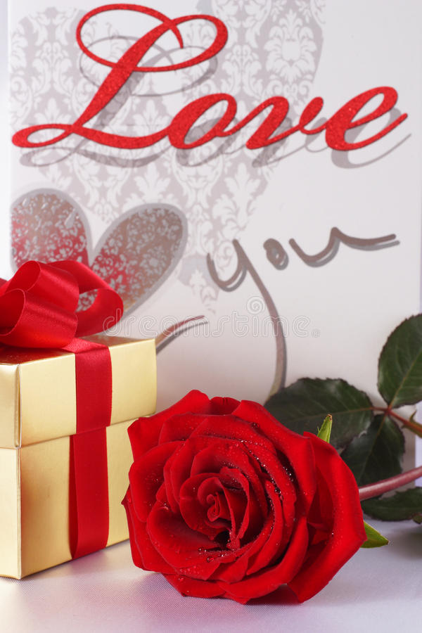 Download Golden Gift Box And Red Roses On White Satin Background Stock Photo - Image: 29746634