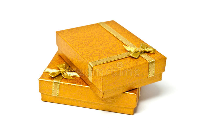Golden gift boxes. Two gift boxes in gold color tone stock photos