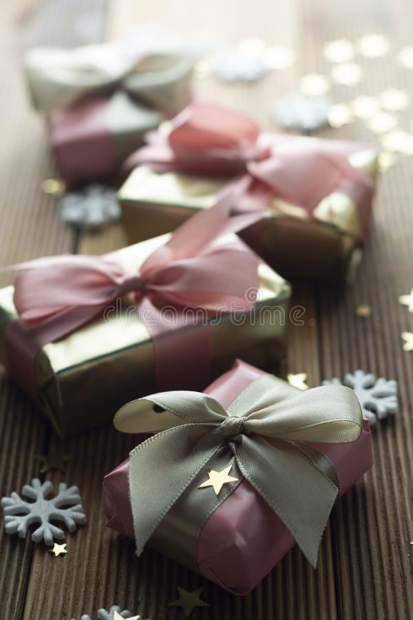 Beautiful golden gifts Christmas, party, birthday background. Celebrate shinny surprise boxes copy space wooden background royalty free stock photography