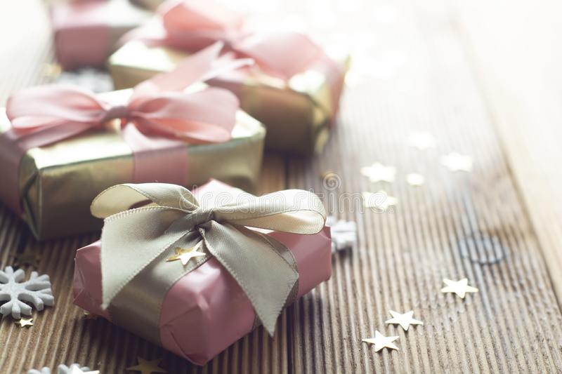 Beautiful golden gifts Christmas, party, birthday background. Celebrate shinny surprise boxes copy space wooden background stock images